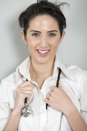 Beautiful young doctor standing with stethoscope Stock Photo - 19070991