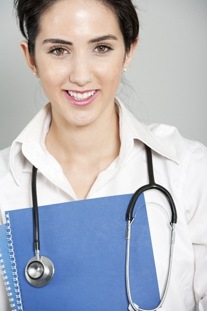 Beautiful young doctor standing with stethoscope Stock Photo - 19070986