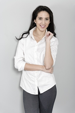 Attractive young woman in white shirt smiling and laughing Stock Photo - 19070975