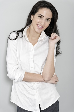 Attractive young woman in white shirt smiling and laughing Stock Photo - 19070979