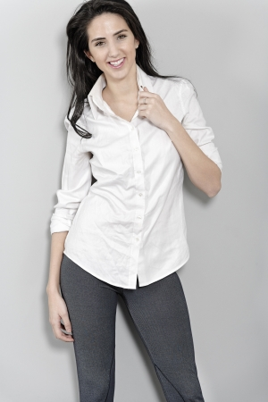 Attractive young woman in white shirt smiling and laughing Stock Photo - 19070993