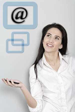 Woman holding out her mobile phone which is displaying an email symbol Stock Photo - 19070872