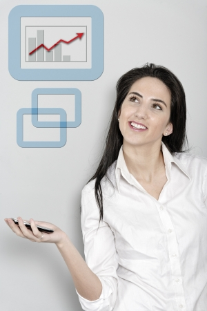Woman holding out her mobile phone which is displaying a positive increase in the form of a chart Stock Photo - 19070873