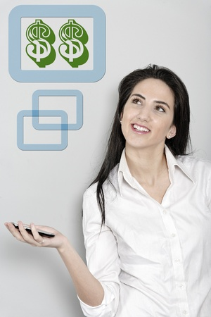 Woman holding out her mobile phone which is displaying dollar sign Stock Photo - 19070877