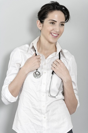 Beautiful young doctor standing with stethoscope Stock Photo - 19070964
