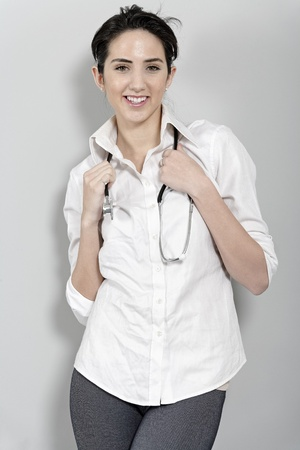 Beautiful young doctor standing with stethoscope Stock Photo - 19070987