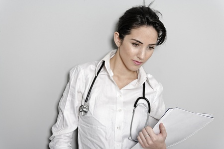 Beautiful young doctor standing with stethoscope Stock Photo - 19070888
