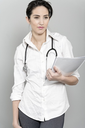 Beautiful young doctor standing with stethoscope Stock Photo - 19070994