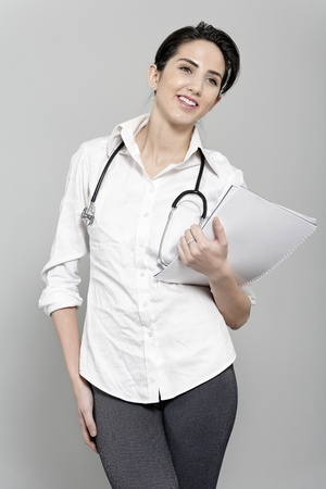 Beautiful young doctor standing with stethoscope Stock Photo - 19070980