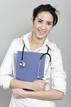 Beautiful young doctor standing with stethoscope Stock Photo - 19070960
