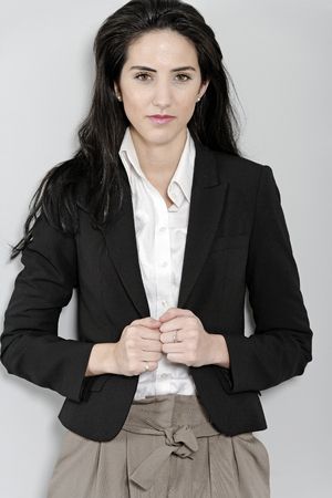 Professional young business woman in smart clothes photo
