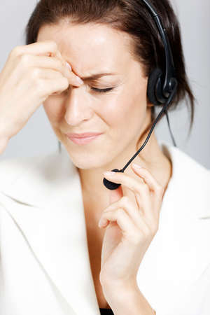 Call centre lady expressing concern and worry photo