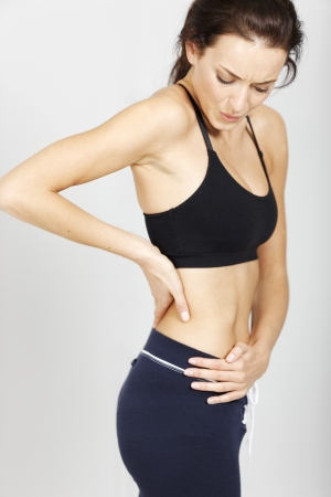 Young woman with muscle pain after fitness workout. photo