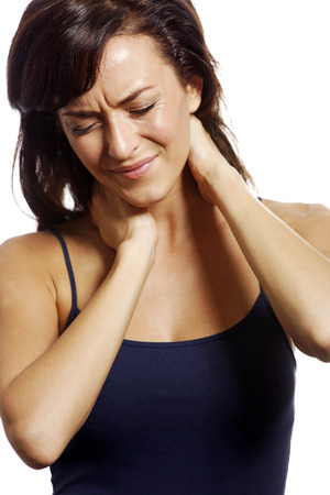 Young woman holding her aching neck photo