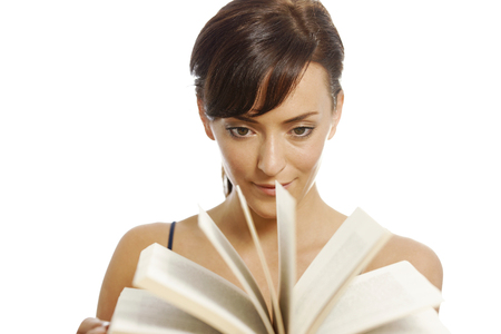 flicking: Young woman flicking through the pages of a book Stock Photo