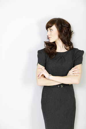 business dress: Professional young business woman looking concerned and worried. Stock Photo