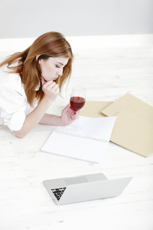 working from home: Young woman working from home