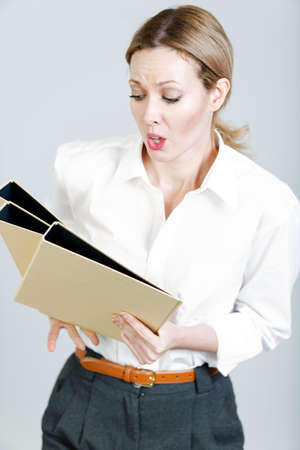 over worked: Professional business woman juggling folders and looking stressed
