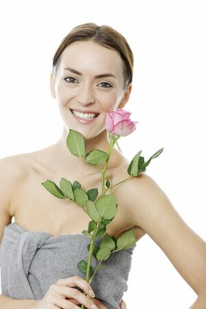 hair wrapped up: Attractive young woman holding a pink rose