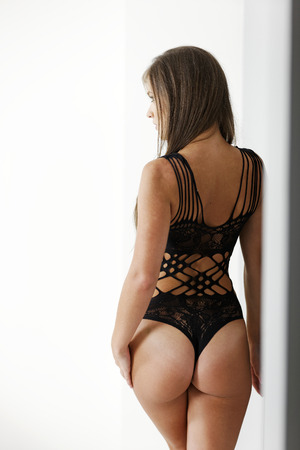 Attractive young woman in one piece black lingerie Stock Photo