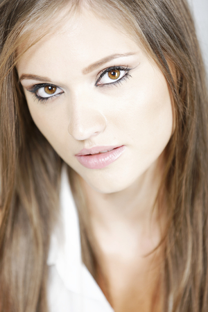Attractive young womans face with long brown hair
