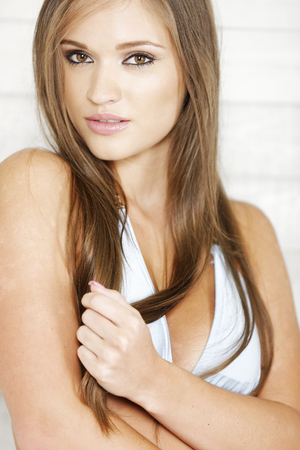 bathing costume: Attractive young woman wearing a light blue bikini
