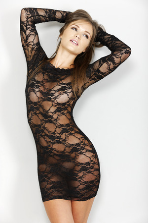 sheer: Sexy woman in black one piece lingerie which is sheer Stock Photo