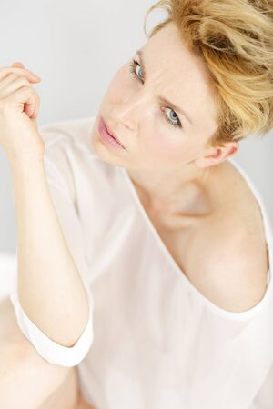 sheer: Beautiful young woman in a sheer pink blouse in a beauty style pose