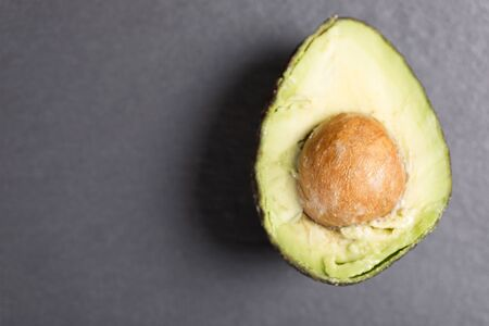 hass: Exotic fresh avocado on black slate with copy space Stock Photo