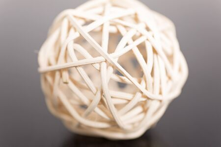 detailed view: detailed view of a white wicker ball which is scented