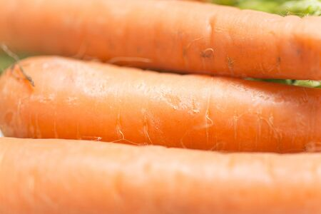 selections: Selections of raw fresh organic carrots on a light wooden work surface