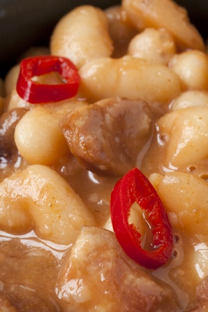 sausage pot: dish made of beans and sausage in a pot Stock Photo
