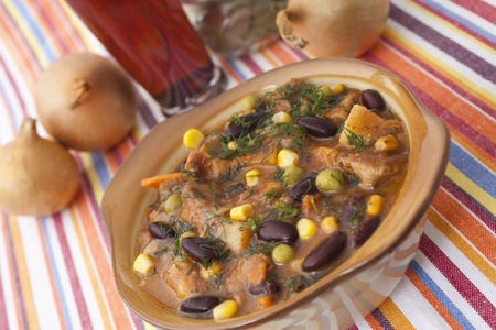 dish with beans and meat for dinner photo