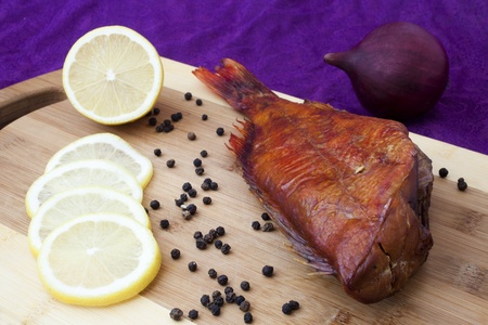 smoked fish on the kitchen board Stock Photo - 11127463