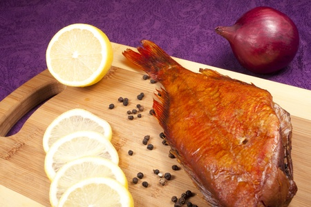 smoked fish on the kitchen board Stock Photo - 11127465