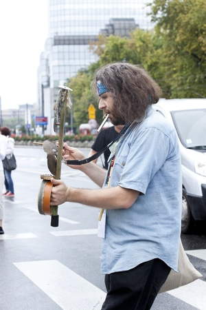 Warsaw, august 26, 2012,- Musician with a strange instrument on Warsaw Multicultural Street Parade
