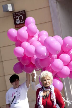 WARSAW, POLAND, September 8: Balloons and woman on XV Pink Ribbon Walk against the Breast Cancer september 8, 2012 in Warsaw, Poland.