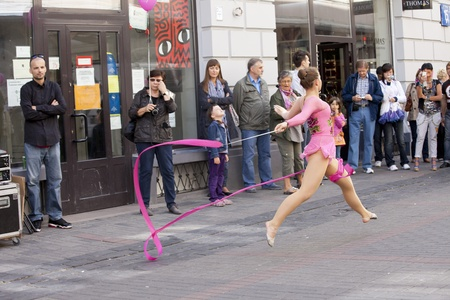 WARSAW, POLAND, September 8: Rhythmic gymnastics show on the 15th Pink Ribbon Walk against the Breast Cancer september 8, 2012 in Warsaw, Poland.  Editorial