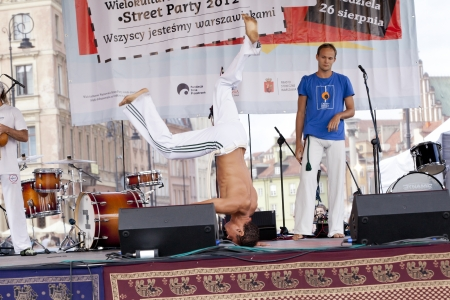 WARSAW, POLAND, AUGUST 26: Unidentified capoeira dancers on the stage on Warsaw Multicultural Street Parade on August 26, 2012 in Warsaw, Poland. Stock Photo - 16309666