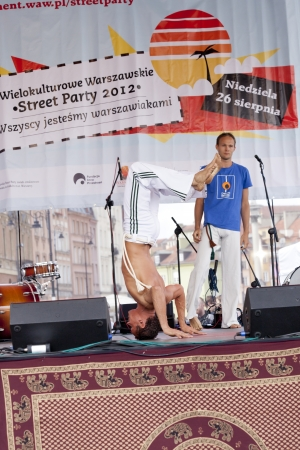 WARSAW, POLAND, AUGUST 26: Unidentified capoeira dancers on the stage on Warsaw Multicultural Street Parade on August 26, 2012 in Warsaw, Poland. Stock Photo - 16309665