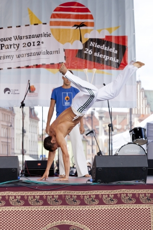WARSAW, POLAND, AUGUST 26: Unidentified capoeira dancers on the stage on Warsaw Multicultural Street Parade on August 26, 2012 in Warsaw, Poland. Stock Photo - 16309664