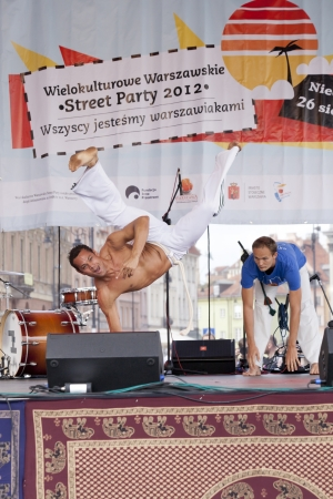 WARSAW, POLAND, AUGUST 26: Unidentified capoeira dancers on the stage on Warsaw Multicultural Street Parade on August 26, 2012 in Warsaw, Poland. Stock Photo - 16309661