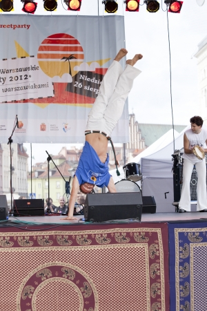 WARSAW, POLAND, AUGUST 26: Unidentified capoeira dancers on the stage on Warsaw Multicultural Street Parade on August 26, 2012 in Warsaw, Poland.