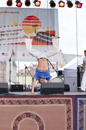 WARSAW, POLAND, AUGUST 26: Unidentified capoeira dancers on the stage on Warsaw Multicultural Street Parade on August 26, 2012 in Warsaw, Poland. Stock Photo - 16309667