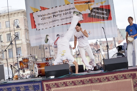 WARSAW, POLAND, AUGUST 26: Unidentified capoeira dancers on the stage on Warsaw Multicultural Street Parade on August 26, 2012 in Warsaw, Poland. Stock Photo - 16309669