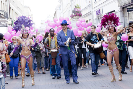 WARSAW, POLAND, SEPT 8  Unidentified Carnival dancers on the XV Ribbon Walk against the Breast Cancer september 8, 2012 in Warsaw, Poland  Editorial