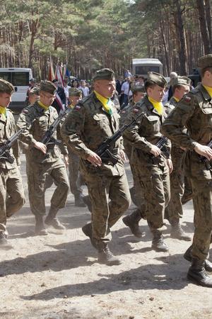 guerrilla: Jerzyska, Poland, Sept 18  Unidentified soldiers at the outdoor anniversary mass- place where AK soldiers was  shooten, september 18, 2013 in Jerzyska, Poland