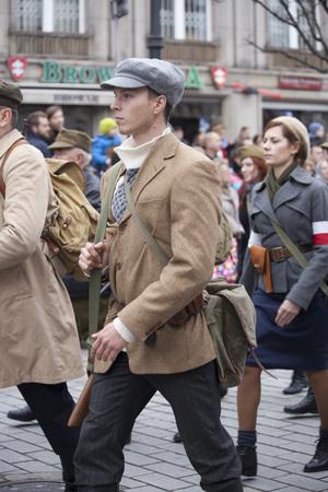 partisan: Warsaw, Poland - 11 November, 2015. The parade of military  reenactors groups.