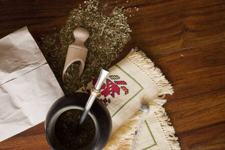 mate: yerba mate gourd on wooden table Stock Photo