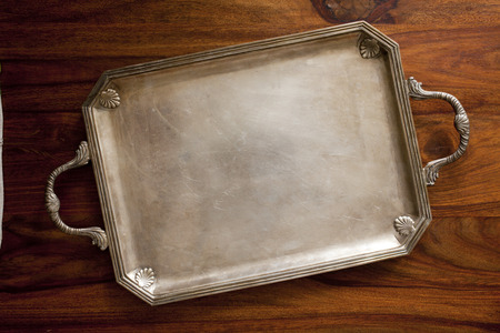 grunge silverware: old retro tray on table Stock Photo